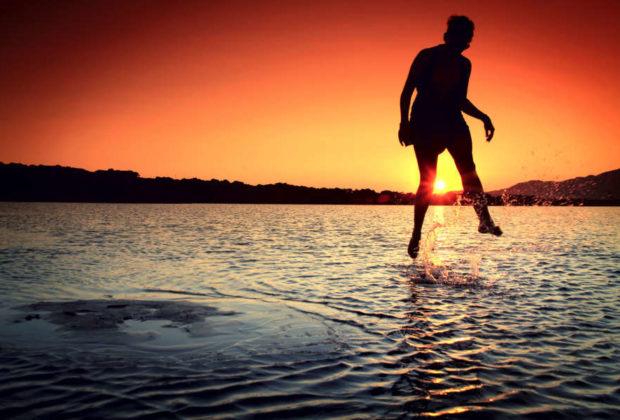 sea dawn sunset person
